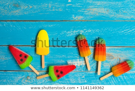 Ice cream stick placed on a blue vintage wooden  Stock photo © manaemedia