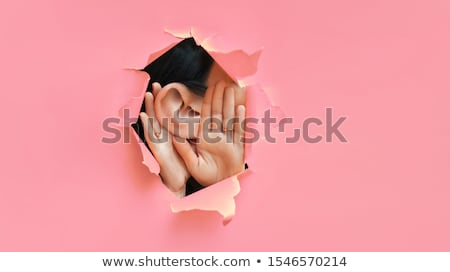 woman eavesdropping gossip secrets and rumors stock photo © rogistok