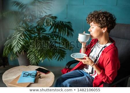 Jeune femme aromatique café thé dégustation Photo stock © pressmaster