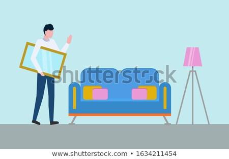 Man spiegel fotolijstje handen kamer sofa Stockfoto © robuart
