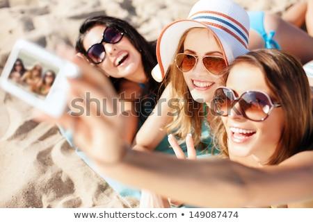 bikini, hat, camera and sunglasses on beach sand Stock photo © dolgachov