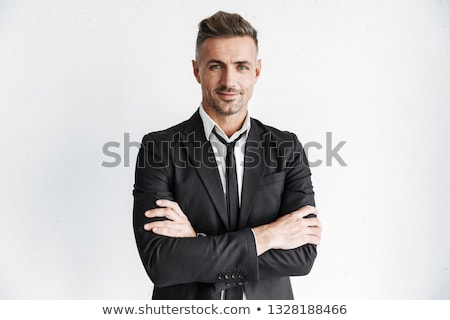 Friendly businessman with folded hands. Stock photo © lichtmeister