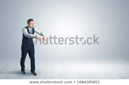 zombi businessman walking in a copy space stock photo © ra2studio
