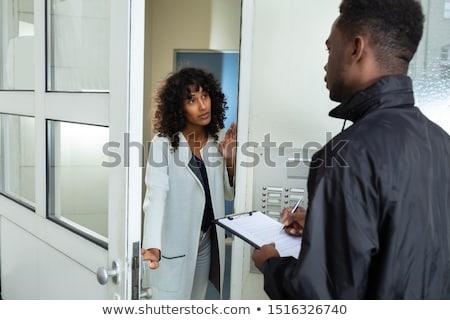 Woman Opening Door To Bailiff Stock photo © AndreyPopov