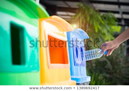 Woman Throwing Plastic Bottle In Recycling Bin Stock photo © AndreyPopov