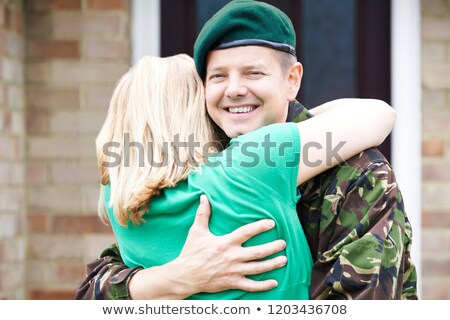 Portrait Of Wife Hugging Army Husband Home On Leave Stock photo © HighwayStarz