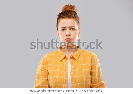 sad red haired teenage girl in shirt pouting Stock photo © dolgachov