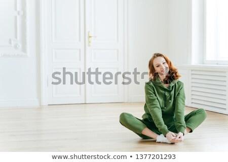 Fotó elragadtatott vörös hajú nő női lótusz póz Stock fotó © vkstudio