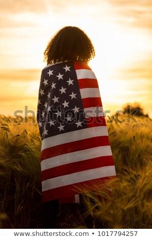Jovem bandeira americana branco azul parede menina Foto stock © dashapetrenko