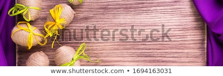 Banner of Easter egg in twine near wooden background. Stock photo © Illia