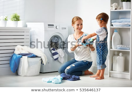 Woman Loading Dirty Clothes In Washing Machine For Washing Stock photo © AndreyPopov
