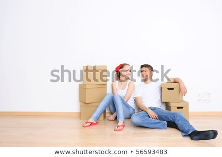 Young woman moving into a new home. Great copy space. stock photo © HASLOO
