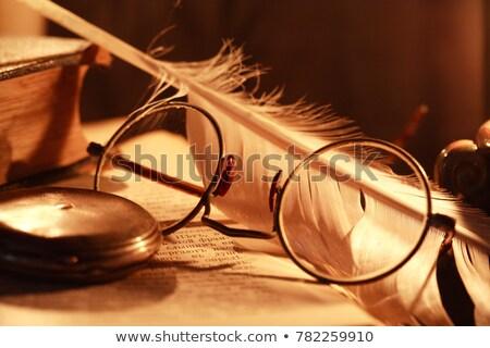 Szemüvegkönyvek és gyertya Stock fotó © cosma