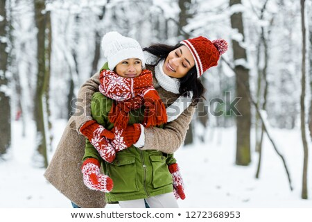 Mother and daughter in snow Stock photo © photography33