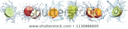 Stock photo: Fresh lemon and water splash on red