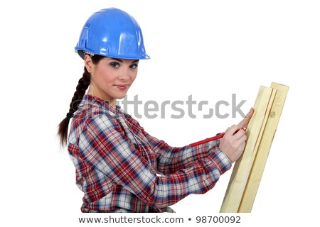 Femenino carpintero toma bordo casa madera Foto stock © photography33