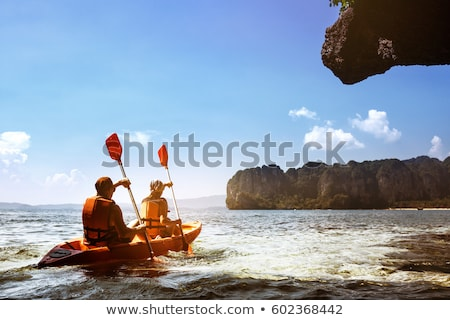 Stock photo: Young couple in a paddle boat
