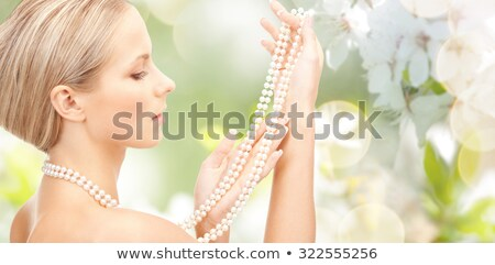 beautiful woman with pearl beads Stock photo © dolgachov