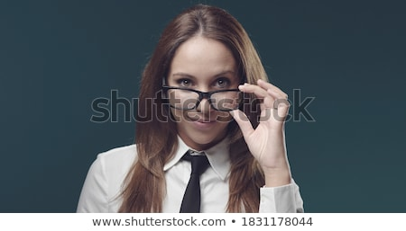 Young businesswoman adjusting her spectacles Stock photo © stockyimages