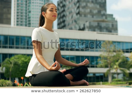 Business woman relaxing in the lotus position stock photo © joseph73