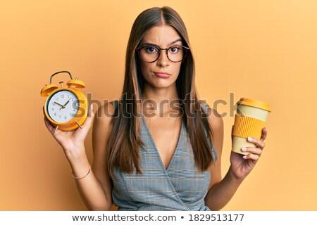 Mogorva nő tart ébresztőóra arc szépség Stock fotó © photography33