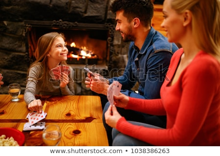 Boy and Girl playing with cards Stock photo © zzve