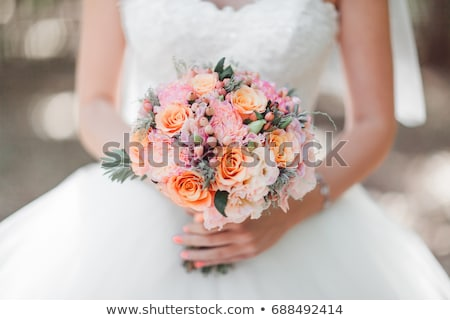 Stock photo: Garter and wedding rings