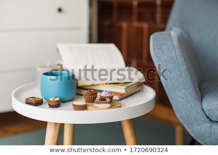 Pralines and book Stock photo © badmanproduction