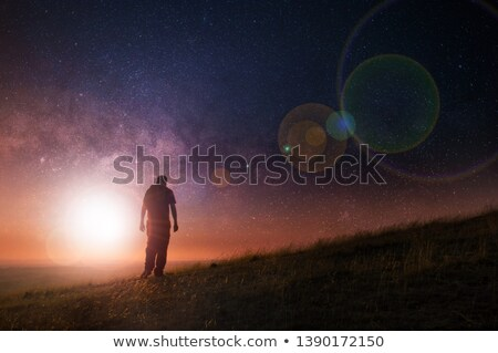 lonely man walking toward mountain Stock photo © elwynn