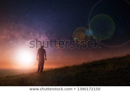 lonely man walking toward mountain stock photo © elwynn