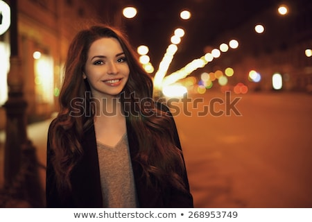 attractive brunette woman against night city stock photo © nejron