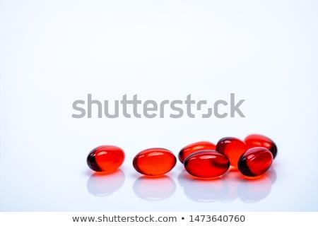 красный капсулы изолированный белый медицинской фон Сток-фото © natika