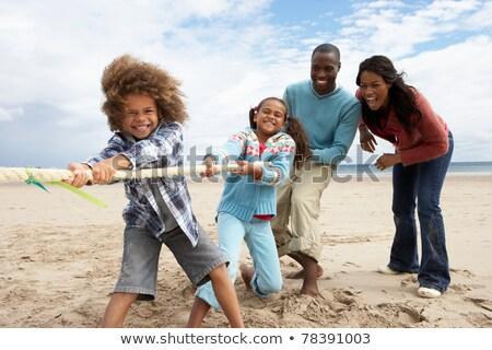 vidám · család · játszik · háború · tengerpart · nő - stock fotó © monkey_business