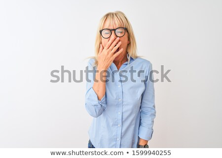 Mature woman yawning Stock photo © bmonteny
