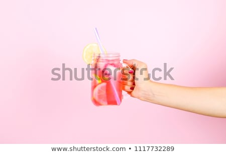 citrus cold cocktail in hand girls stock photo © oleksandro