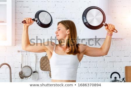 Woman Holding Frying Pan Stock photo © piedmontphoto