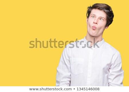 Junger Mann lustiges Gesicht weiß 20 Jahr Stock foto © aladin66