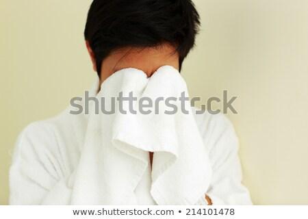 Jonge man badjas gezicht handdoek man gezondheid Stockfoto © deandrobot