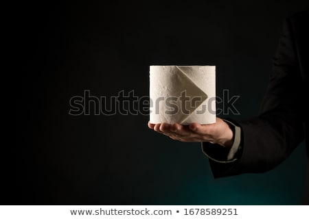 man in toilet holding tissue paper roll stock photo © andreypopov