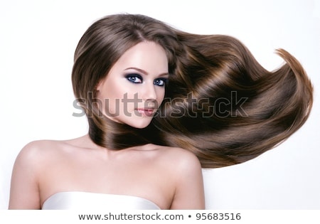 Attractive girl with long hair lying stock photo © NeonShot