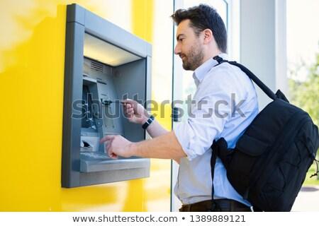 man withdrawing money Stock photo © stryjek