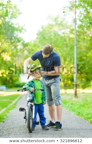 father attaching his son cycling helmet stock photo © wavebreak_media