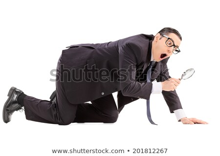 Business man inspecting something Stock photo © fuzzbones0