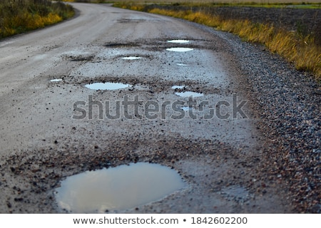 dirty road with puddle Stock photo © Mikko