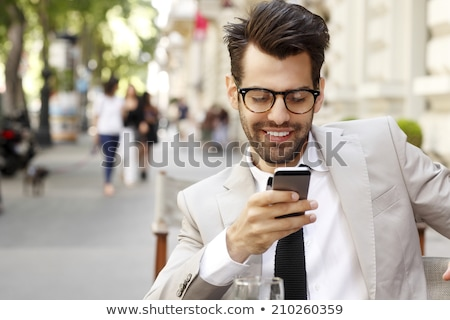 seated young business man looks up stock photo © feedough