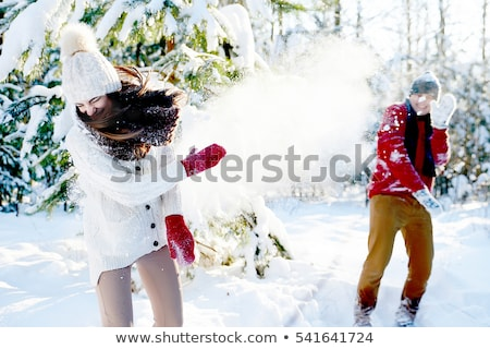 Couple playing snowballs in winter forest Stock photo © deandrobot