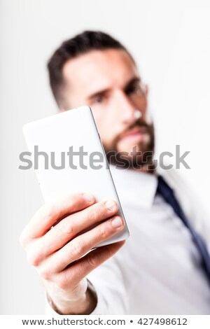 businessman with smartphone solving the whole thing Stock photo © Giulio_Fornasar