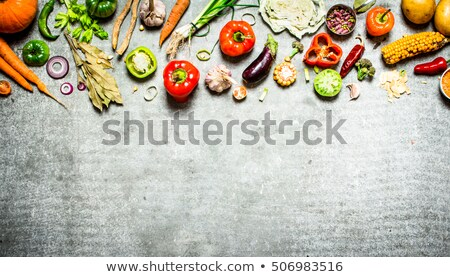 Slice vegetables and fruit on natural slate stone background  Stock photo © tab62