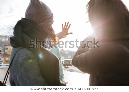 Back view photo of young asian man with caucasian lady Stock photo © deandrobot