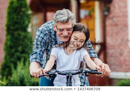 Nagyapa tanít leányunoka bicikli erdő férfi Stock fotó © wavebreak_media